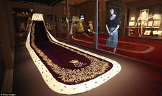 Queen Elizabeth II's coronation robe features in a new exhibition at Buckingham Palace of the lavish clothes worn at the ceremony in 1953