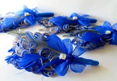 Boutonniere Wedding Groom Groomsmen Royal Blue by parfaitplumes, #wedding#groom#groomsmen#boutonierre#bout#lapelpin#grey#royal blue  This listing is for a set of 4 boutonnieres  These boutonnieres are made using royal blue and grey nagorie feathers layered then curled at the edges . Added touches of royal blue spears and a single emu plume. A small central rhinestone pick adds a little sparkle.  Wrapped with the royal blue satin ribbon and a chiffon ribbon bow.