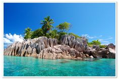 Seychelles, dreamlike 115 islands in the Indian Ocean. Enchanting beaches; white sand lapped by tourquoise waters and backed by fascinating hills and boulders.