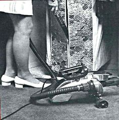 """This 1975 photo shows the Kirby Crystalator attachment in use. It was used to """"de-moth"""" closets and garment bags."""