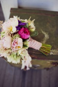 purple, ivory, and fuchsia bouquet shot by Sarah Kathleen