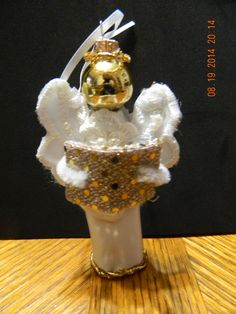 i made this angel with a Christmas ornament, material, wooden peg, pipe cleaners, ribbon