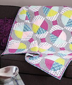 On the Dot, featured in Love of Quilting September/October 2013, is a throw size quilt patttern featuring appliqué circles made in modern fabrics. Quilt by Tonya Alexander.