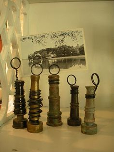 Old garden hose sprayers as picture holders