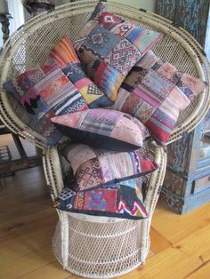 Love tis boho Peacock chair with Gypsy River eclectic handcrafted pillows