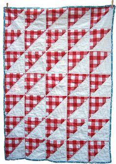 red and white cornered gingham quilt