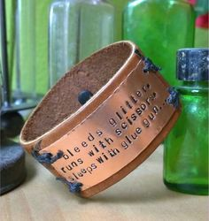 Do you bleed glitter? Do you run with scissors? Do you sleep with a glue gun? If you're guilty as charged, then the Crafter's Motto Cuff is the project for you.