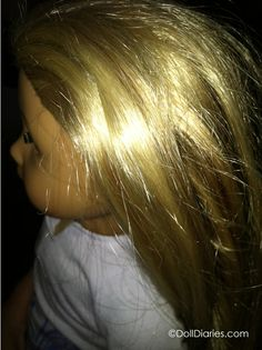 """""""how can I tame the frizzies in my doll's hair?"""" A pretty common technique is to give your doll a """"Downy Dunk"""" – where you wash your dolls' hair, then soak it for an extended time in Downy fabric softener.  Experienced doll collector gave me the basic tip – put two tablespoons of liquid Downy fabric softener in a spray bottle of water and just spritz your doll's hair with the softener solution any time you need to give her a touch up."""