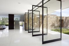 Large pivoting doors opening up the interior towards the garden. The Madison House by XTEN Architecture.