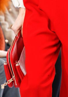 red on red on red, hot red pants and matching bag.