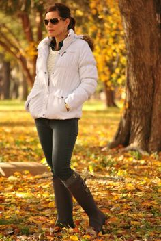 Cold weather outfit - puffer jacket, gray jeans and rain boots.