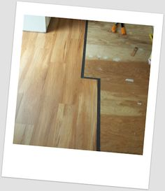 Installing vinyl plank flooring in the trailer, had to cut it with garden shears. Phew!