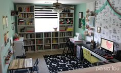 Craft room tour. Love the wire baskets and washi tape storage she uses!