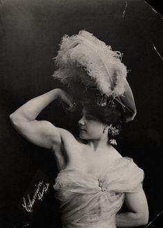 Laverie Vallee  (July 18, 1875 - February 6, 1949) Best known by her stage name  Charmion , was a Sacramento born trapeze artist who possessed strength and a physique MOST men would be envious of. However, she was MOST Well Known for her risqué striptease performances.   The act opened with Charmion taking the stage in full Victorian attire. She would then mount the trapeze and proceed to undress to her leotard while performing impressive and strength-dependent stunts.