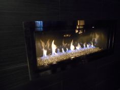 brand new linear direct vent gas fireplace from Mendota with metallic panoramic interior, glass media and Swedish nickel trim. Seen at #HPBEXPO glass media, gas fireplaces