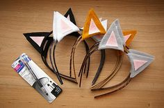 Ordered 12 black headbands from eBay, bought black and pink felt to cut and glue gun cat ears.  kitty cat party