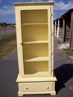 Shabby cottage chic. Repurposed gun cabinet.