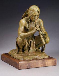 Native American Flute player statuette