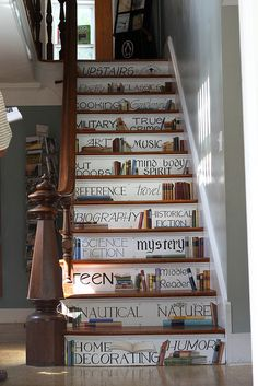 Library Stairs. book selections painted on stairs. nice.