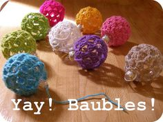 Baubles by meetmeatmikes, via Flickr  pictorial crochet ornament covers