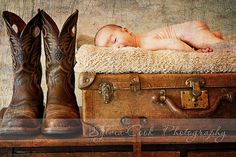 Newborn with cowboy boots