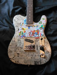 Spiderman tele style electric guitar with custom by ComicDecor, £150.00