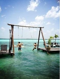 i wouldnt have my feet touch the water so i would hang the swings higher so you could jump off into the water