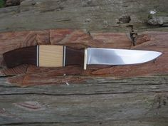 "RedEyedJack custom knives Scandi style hunting knife, 70% flat ground 1/8"" 1095 high carbon steel, Ipe & Maple handle with black, grey, & white spacers. Brass guard. $85.00 + s Handmade in U.S.A. with pride. find us on Facebook REJck RedEyedJack custom knives of Bonifay, Florida. E-mail redeyedjackcustomknives@yahoo.com"
