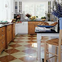 Striped, polka dot, checkerboard, or plaid, pattern adds spunk to a vanilla kitchen. Here, extra-large diamonds add bold interest and make the space look larger. Patterned floors make all the difference! Coastalliving.com