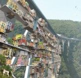 Parasitic city takes over decommissioned Italian bridge:  http://bit.ly/1sXFSLy