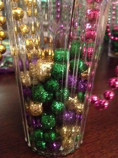 mardi gras glitter balls in vase