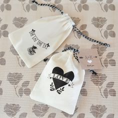 Vintage baby shower muslin bags with personalized tags