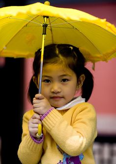 Young girl with an umbrella, Beijing, China