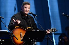 He still believes in country music. Vince Gill performs at the grand opening of the newly expanded Country Music Hall of Fame and Museum on April 15, 2014 in Nashville, Tenn.