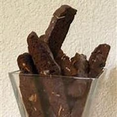 Brownie Biscotti - used 3 large eggs and walnuts. Added espresso powder. Very tasty. Dipped one end in dark chocolate.  Will make again. May replace water with Kahlua or coffee next time. ~Suz