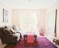kushy grey sofa and fuschia rug