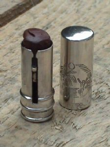 Vintage Tattoo Silver Plated Lipstick - Pagan Red, Circa 1930s. Engraved Sailor Jerry style hula scene on the tube.