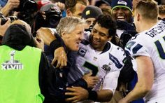 JERRY BREWER: Seahawks head coach Pete Carroll and quarterback Russell Wilson hug as they are swarmed on the field after Se...