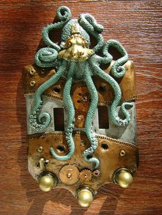 Green Steampunk Octopus Double Light Switch Cover Key Chain Holders. Animal Wall Art Sculpture Wall Decor Decorative Arts. $27.00, via Etsy.