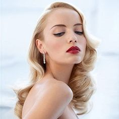 Stylish and glamorous with a red lip and black liner.
