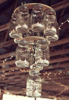 Mason Jar Chandelier. I love this. What a pretty piece to decorate. This one was used at a wedding, but the look and feel of these mason jar chandeliers are perfect anywhere. Here is a DIY for a mason jar chandelier, this one is for an electrical chandelier so you'd need to adapt it.