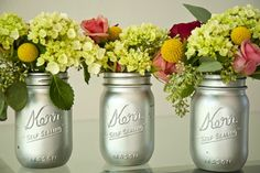 Silver spray painted mason jars.  Cute idea.