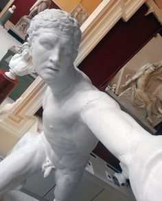 statues taking selfies at ireland's crawford art gallery