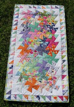 Lil Twister quilt using a charm pack of Kate Spain Terrain and Kona White