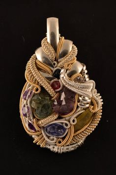 Pendant   Daniel of Twistedwerx.  Hand sculpted in sterling fine and argentium silver with 14k yello gold-filled accents and mixed semi precious stones