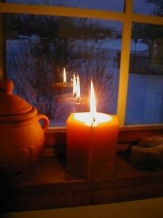An Irish tradition, a candle in the window lights the way for weary travelers at Christmas time.