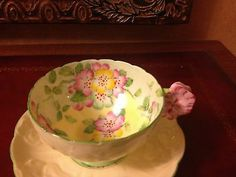 Beautiful Paragon Flower Handle Teacup Tea Cup Saucer nice next to a teapot