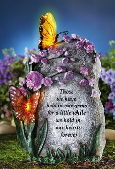 """Butterfly Memorial Stone By Collections Etc by Mallory Lane. $16.99. Keep the memory of a departed loved one glowing each night. Garden tribute has the look of real stone decorated with blossoms and butterflies that glow with solar powered light each evening. Includes a solar-recharging """"AA"""" battery. Polyresin. 7""""L x 5""""W x 11 1/2""""H."""