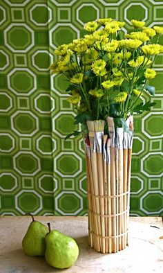 Don't you love that this use for paintbrushes not only spruces up the outside of a vase (or an empty jar or can), but still enables you to use the paintbrushes?    It's a clever way to store art or office supplies such as brushes, pencils, pens, and rubber bands.    (via DudeCraft)