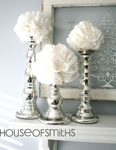 Napkin Snow Puffs on Candle Holders. (I would find some cheapo candle holders at garage sales/goodwill and mercury glass coat them)